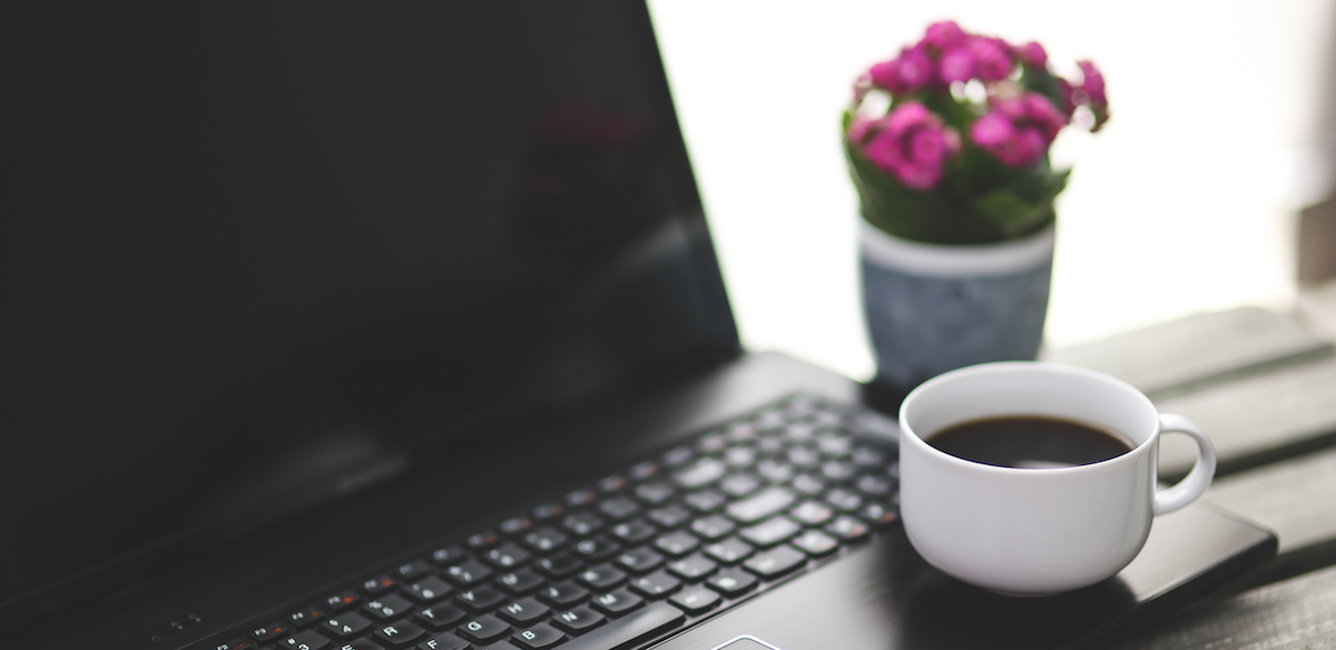 Computer, coffee, flowers